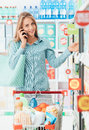 Woman having a phone call at the store Royalty Free Stock Photo