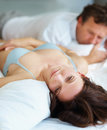 Woman having problems in bed with husband Royalty Free Stock Photography