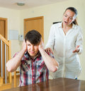 Woman having problems with her husband european at home Royalty Free Stock Image