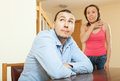 Woman having problems with her husband family conflict at home Stock Image