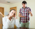 Woman having problems with her husband spanish women at home Royalty Free Stock Photo