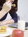 Woman having a snack Royalty Free Stock Photo