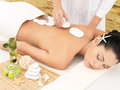 Woman having stone massage of back in salon Royalty Free Stock Photos