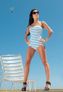 Woman having sun under blue sky Royalty Free Stock Images