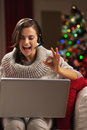 Woman having video chat with family in front of christmas tree Royalty Free Stock Photo