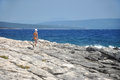 Woman having a walk on the beach in swimwear adriatic sea croatia Stock Photos