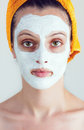 Woman having a white smoothing face mask portrait of sake and rice Royalty Free Stock Photo