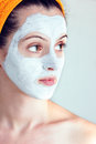 Woman having a white smoothing face mask portrait of sake and rice Royalty Free Stock Photos