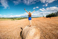 Woman on the hayfield Royalty Free Stock Photo