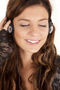 Woman head phones eyes closed Royalty Free Stock Photos