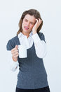 Woman with headache holding mug on white background Stock Image