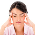 Woman with a headache isolated over white background Royalty Free Stock Image