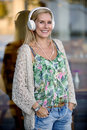 Woman with headphones blonde standing Royalty Free Stock Images