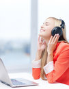 Woman with headphones happy listening to music Royalty Free Stock Photos