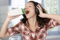 Woman with headphones and plant microphone Royalty Free Stock Photography