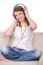 Woman with headphones young beautiful listening to music in their homes Stock Photo