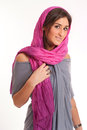 Woman with headscarf pretty brunette a pink silk Royalty Free Stock Photography