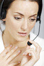 Woman with headset call centre lady expressing concern and worry Royalty Free Stock Photography
