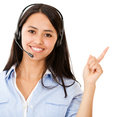Woman with headset pointing Royalty Free Stock Photo