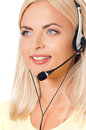 Woman with headset smiling female helpline operator headphones giving a consultation Stock Photography
