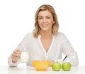 Woman with healthy breakfast picture of in casual clothes Royalty Free Stock Image