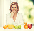 Woman with healthy breakfast picture of in casual clothes Royalty Free Stock Images