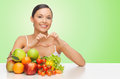 Woman with healthy food showing heart shape sign
