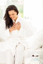Woman heart attack young in pajamas having Royalty Free Stock Photography