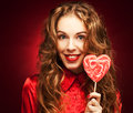 Woman with heart caramel over red background Royalty Free Stock Photo