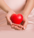 Woman with heart in hands give love valentine s day closeup Stock Image