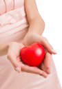 Woman with heart in hands give love valentine s day isolated Stock Photo