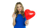 Woman with heart shaped balloons beautiful blond smiling and holding red valentines day half body portrait isolated over white Royalty Free Stock Images