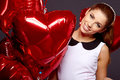Woman with a heart shaped balloons beautiful young Stock Images