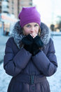 Woman heating hands at cold winter weather Stock Photo