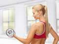 Woman with heavy steel dumbbell Stock Image