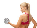 Woman with heavy steel dumbbell close up of young sporty Royalty Free Stock Photo