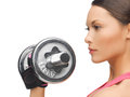 Woman with heavy steel dumbbell picture of young sporty Royalty Free Stock Images