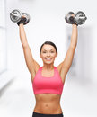 Woman with heavy steel dumbbells Stock Photos