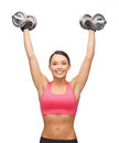 Woman with heavy steel dumbbells picture of young sporty Royalty Free Stock Photography