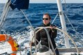 Woman at the helm captain of big cruising yacht Royalty Free Stock Image