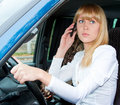 Woman after the helm of car Stock Photo