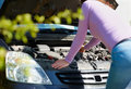 Woman with her broken down car Stock Photo