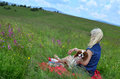 Woman and Her Dog in Hilly Landscape Royalty Free Stock Photo
