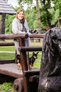 Woman and her dog smiling standing on a old wooden cart with Stock Photography