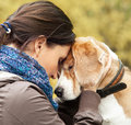 Woman with her dog tender scene Royalty Free Stock Photo