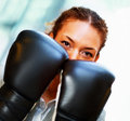 Woman with her face covered by boxing gloves Royalty Free Stock Photos