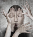 Woman with her hands on the grunge backround surreal concept photo manipulation Stock Photos