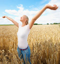 Woman with her hands raised out in an  open farm Stock Photography