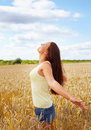 Woman with her hands raised out in the open farm Royalty Free Stock Photos