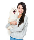 Woman with her happy doggy isolated on white background Royalty Free Stock Photo